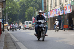 Unidentified riders ride motorbikes on busy road ,Hanoi, Vietnam. Royalty Free Stock Photos
