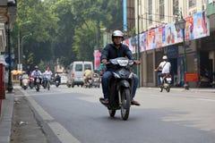 Unidentified riders ride motorbikes on busy road ,Hanoi, Vietnam. Royalty Free Stock Photos