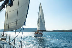 Unidentified sailboats participate  in sailing regatta on Aegean Sea. Royalty Free Stock Photography