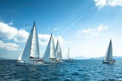 Unidentified sailboats participate in sailing regatta. ERMIONI - POROS, GREECE - OCT 9, 2014: Unidentified sailboats participate in sailing regatta 12th Ellada royalty free stock images
