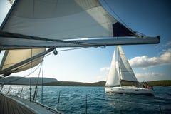 Unidentified sailboats participate in sailing regatta. ERMIONI - POROS, GREECE - OCT 9, 2014: Unidentified sailboats participate in sailing regatta 12th Ellada stock photography