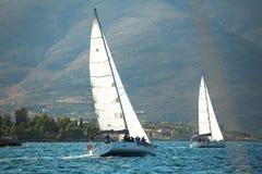 Unidentified sailboats participate in sailing regatta Stock Image