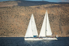 Unidentified sailboats participate in sailing regatta Royalty Free Stock Photos