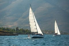 Unidentified sailboats participate in sailing regatta. GALAXIDI, GREECE - SEP 29, 2014: Unidentified sailboats participate in sailing regatta 12th Ellada Autumn royalty free stock images