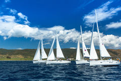 Unidentified sailboats participate in sailing regatta among Greek island group in the Aegean Sea. HYDRA, GREECE - CIRCA OCT, 2014: Unidentified sailboats stock photo