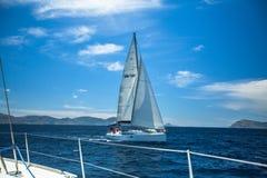 Unidentified sailboats participate in sailing regatta  Stock Photos