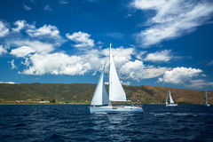 Unidentified sailboats participate in sailing regatta Royalty Free Stock Image