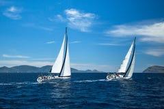 Unidentified sailboats participate in sailing regatta. METHANA - POROS - ERMIONI, GREECE - MAY 4, 2014: Unidentified sailboats participate in sailing regatta royalty free stock images