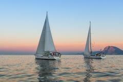 Unidentified sailboats participate in sailing regatta  Stock Photo