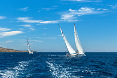 Unidentified sailboats participate in sailing regatta 12th Ellada Autumn 2014 among Greek island group in the Aegean Sea. HYDRA, GREECE - CIRCA OCT, 2014 stock images