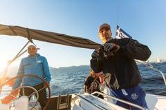 Unidentified sailors participate in sailing regatta Stock Images
