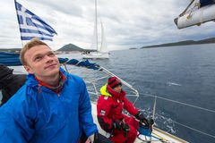 Unidentified sailors participate in sailing regatta 12th Ellada Autumn-2014 on Aegean Sea. Royalty Free Stock Image