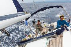 Unidentified sailors participate in sailing regatta 12th Ellada Autumn 2014 among Greek island group in the Aegean Sea. HYDRA, GREECE - CIRCA OCT, 2014 stock photos