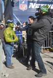 Unidentified Seattle Seahawks fan during interview on Broadway during Super Bowl XLVIII week in Manhattan Stock Photography