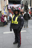 Unidentified security officer providing security at Times Square area in Midtown Manhattan Stock Image