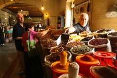 An unidentified seller on central food market Royalty Free Stock Image