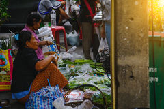 Unidentified seller prepare and sale vegetables on china town Yaowarat Road, Royalty Free Stock Images