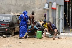 Unidentified Senegalese group of people gather near the car. LAC ROSE reg. , SENEGAL - APR 27, 2017: Unidentified Senegalese group of people gather near the car royalty free stock images