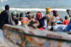 Unidentified Senegalese people gather on the coast of the Atlan. KAYAR, SENEGAL - APR 27, 2017: Unidentified Senegalese people gather on the coast of the royalty free stock photo