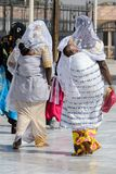 Unidentified Senegalese women carry their babies on their backs. TOUBA, SENEGAL - APR 26, 2017: Unidentified Senegalese women carry their babies on their backs royalty free stock photos