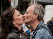 Unidentified senior couple kissing during Gay pride parade Royalty Free Stock Image