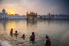 Unidentified Sikh men bath in the holy lake at Golden Temple Royalty Free Stock Photos