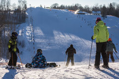 Unidentified skiers enjoy skiing at the slope. Royalty Free Stock Photos