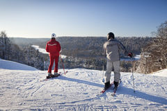 Unidentified skiers enjoy skiing at the slope. Stock Image