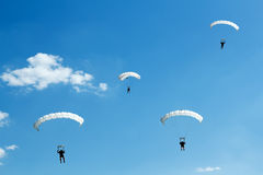 Unidentified skydiver on blue sky Stock Photo