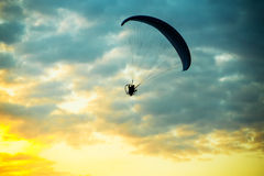 Unidentified skydiver, parachutist on blue sky Royalty Free Stock Images