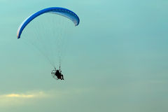Unidentified skydiver, parachutist on blue sky Royalty Free Stock Photos