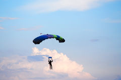 Unidentified skydiver, parachutist on blue sky Royalty Free Stock Photo