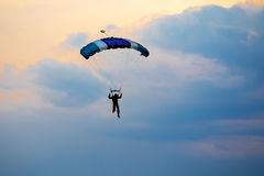 Unidentified skydiver, parachutist on blue sky Stock Image