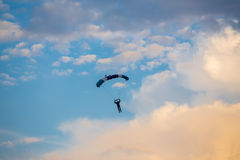 Unidentified skydiver, parachutist on blue sky Stock Photography