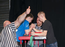 Unidentified sportsmen compete in arm wrestling Royalty Free Stock Images