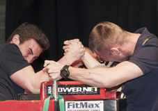 Unidentified sportsmen compete in arm wrestling Stock Image