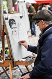 Unidentified street artist on Montmartre Stock Image