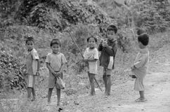 Unidentified street children. PHNOM KULEN CAMBODIA 03 27 13: Unidentified street children posing. Around 30% of the population lives below the poverty line in Royalty Free Stock Image