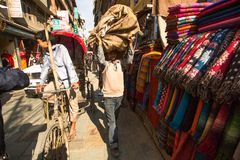 Unidentified street seller in historic center of city, Nov 28, 2013 in Kathmandu, Nepal. Stock Image