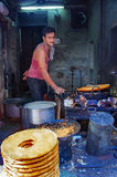 Unidentified street vendor cooks at a  market Royalty Free Stock Image
