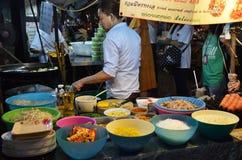 An unidentified street vendor cooks pad thai in Bangkok Stock Photos