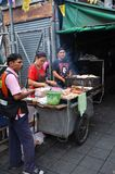 An unidentified street vendor cooks at a roadside restaurant in Royalty Free Stock Photography