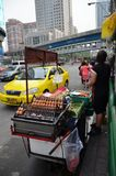An unidentified street vendor cooks at a roadside restaurant in Royalty Free Stock Images