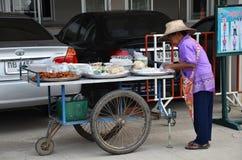 An unidentified street vendor prepares food at street in Bangko Royalty Free Stock Image