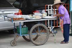 An Unidentified Street Vendor Prepares Food At Street In Bangkok Royalty Free Stock Photography