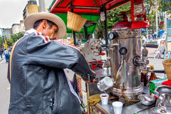 Unidentified street vendor selling fresh coffee at Royalty Free Stock Photography