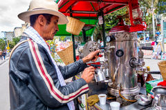 Unidentified street vendor selling fresh coffee at Stock Photo