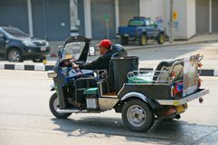 Unidentified taxi driver with traditional tuk-tuk in Thailand. Royalty Free Stock Images
