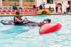 Two Hispanic Men Competes At The Canoeing Contest Stock Photography