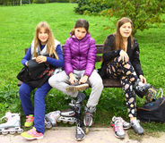 Unidentified teen girls put on roller skates royalty free stock image
